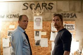 Marty & Rust in Rust's Storage Unit, where's he's continued investigating the rapes/murders and the missing women & children