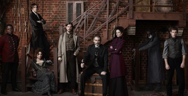 Cast of PENNY DREADFUL (L to R): Danny Sapani as Sembene, Reeve Carney as Dorian Gray, Billie Piper as Brona Croft, Josh Hartnett as Ethan Chandler, Timothy Dalton as Sir Malcolm Murray, Eva Green as Vanessa Ives, Rory Kinnear (in doorway) as Frankenstein's Monster/Creature, Harry Treadawell as Victor Frankenstein