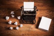 stock-photo-48322464-retro-typewriter-on-a-wooden-desk