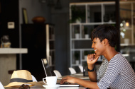 stock-photo-72248995-smiling-young-african-american-woman-working-on-laptop