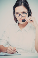 stock-photo-73331023-support-phone-operator-with-headset-at-workplace