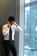 stock-photo-77411153-young-asian-businessman-hearing-bad-news-with-mobile-phone