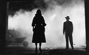 Two silhouetted figures in The Big Combo (1955). The film's cinematographer was John Alton, the creator of many of film noir's stylized images. from Wikipedia